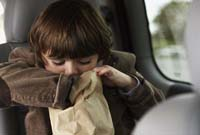 600-01123709© MasterfileModel ReleaseBoy Sitting in Car Looking inPaper Bag